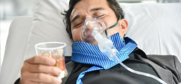 Cool dude on a ventilator drinking two fingers of whiskey