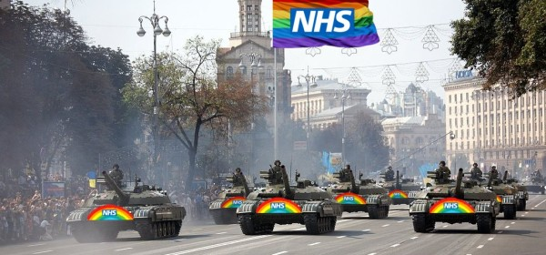 A parade of tanks with NHS rainbows and flags